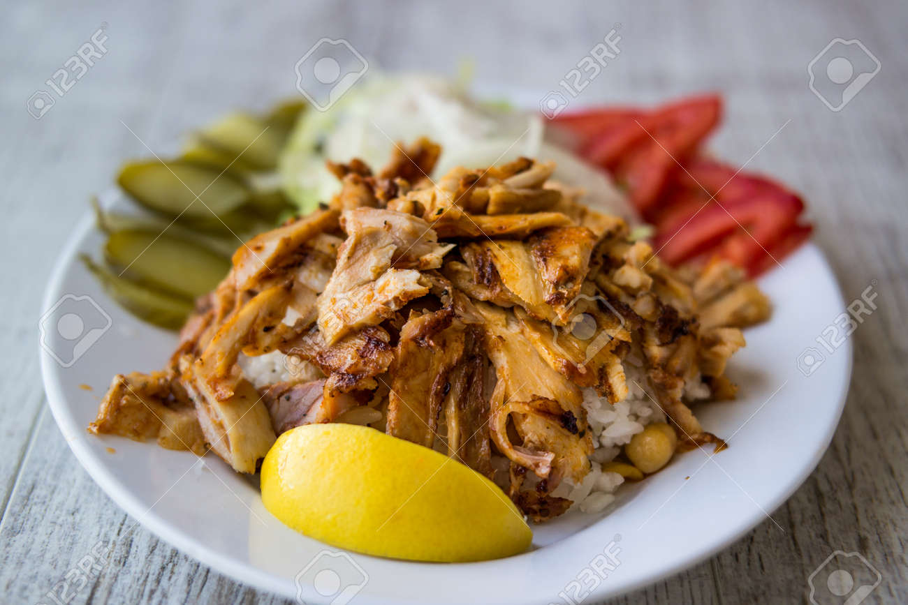 Turkish Chicken Doner Kebab With Rice In A White Plate Stock Photo Picture And Royalty Free Image Image 84683655