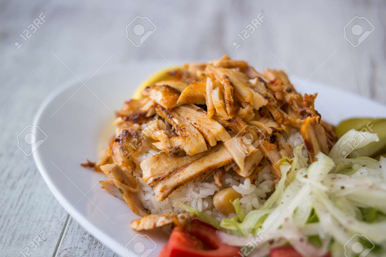 Turkish Chicken Doner Kebab With Rice In A White Plate Stock Photo Picture And Royalty Free Image Image 84639029