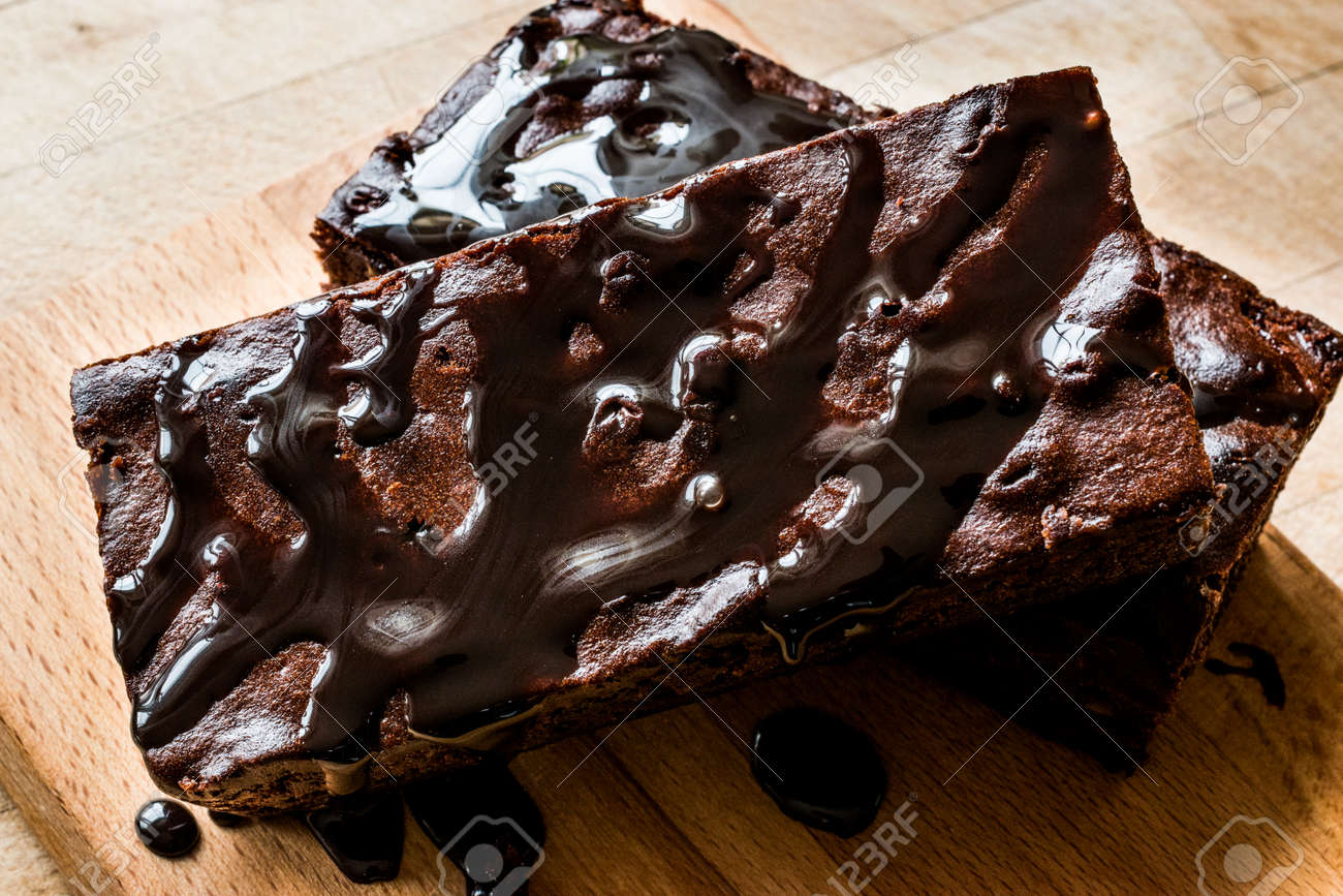 Brownie Cake With Chocolate Sauce On Wooden Surface Dessert Stock