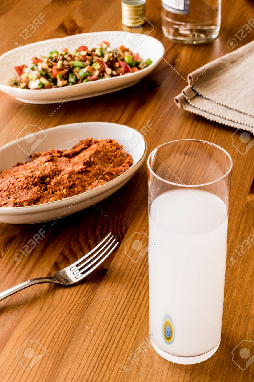 Acılı Ezme turkish drink raki with acili ezme and gavurdagi salad with walnut.