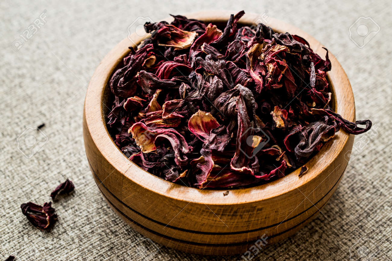 Dried hibiscus flowers in wooden bowl organic concept stock photo dried hibiscus flowers in wooden bowl organic concept stock photo 99793937 izmirmasajfo