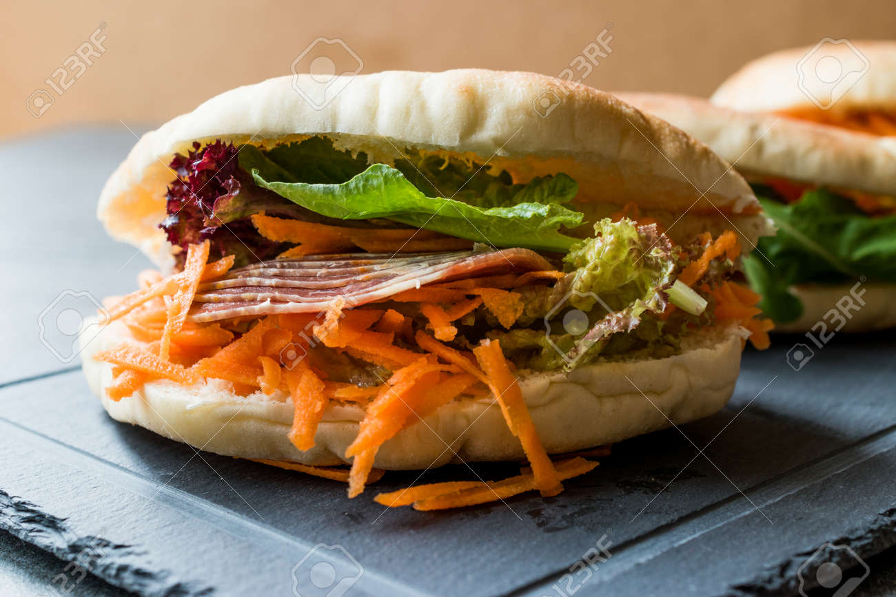 Taiwan's Pita Bread Bun Sandwich Gua Bao with Smoked Bacon, Carrot Slices and Greens from Asia. Traditional Organic Food. - 108001330