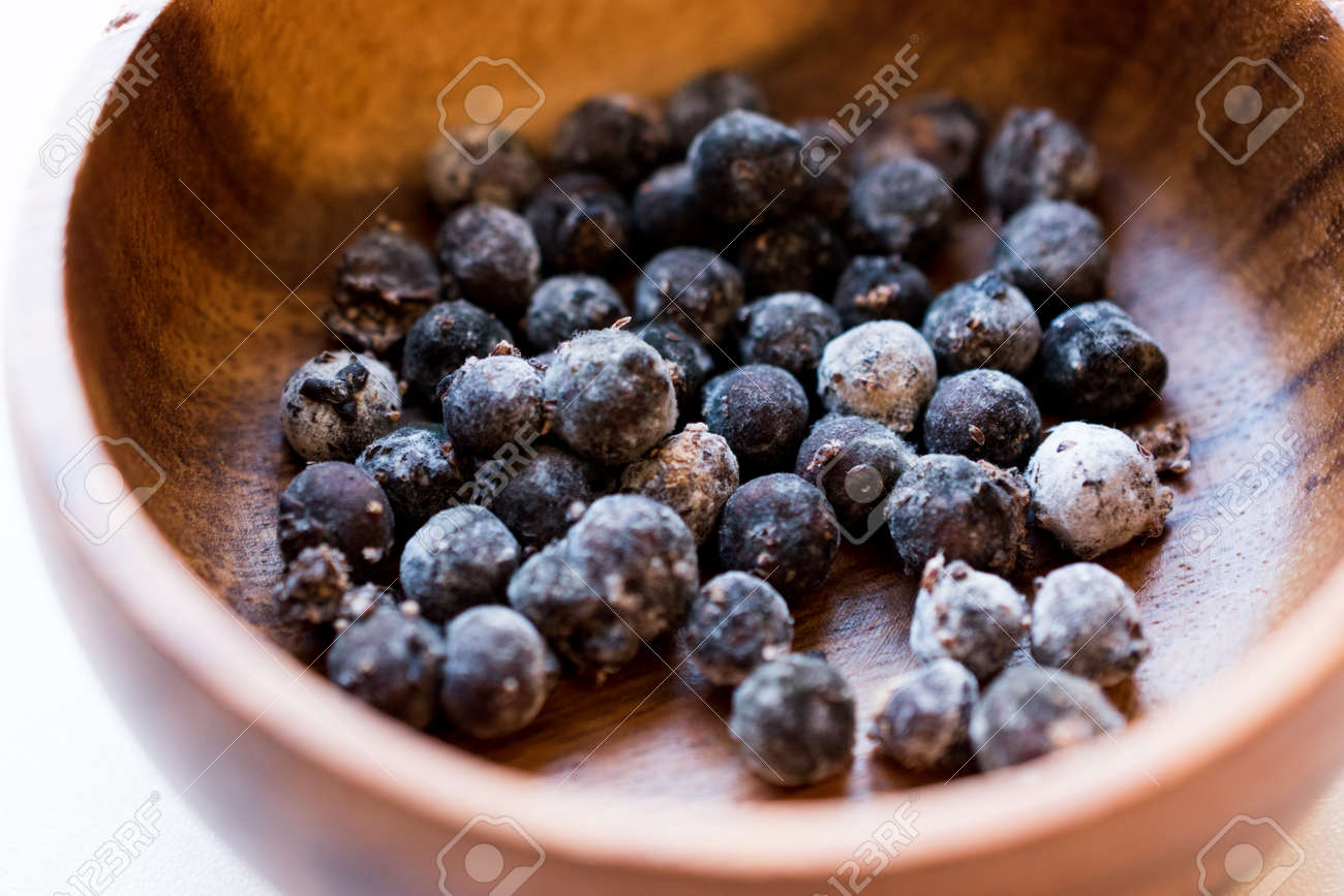 Black Raw Tapioca Pearls in Wooden Bowl  Organic Product