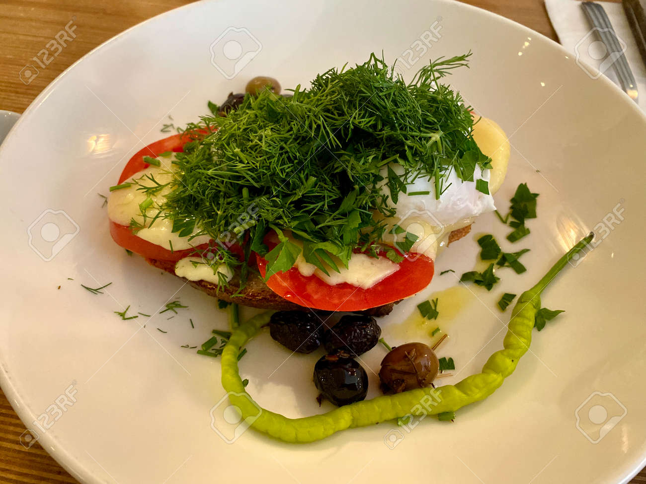 Healthy Breakfast Plate Tartine with Dill, Poached Egg and Green Pepper served at Restaurant. ready to eat. - 173253621
