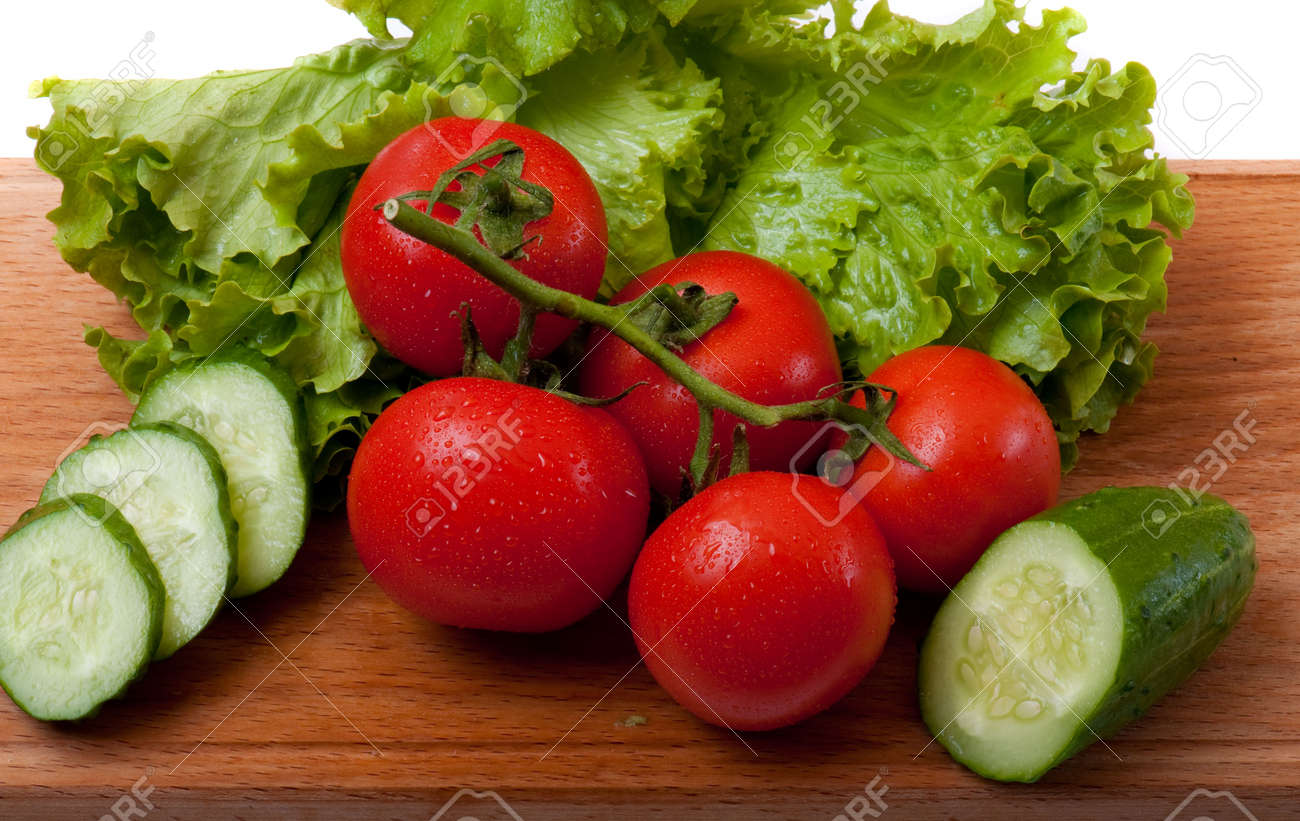 tomato and salad on a wooden cutting board Stock Photo - 6306319