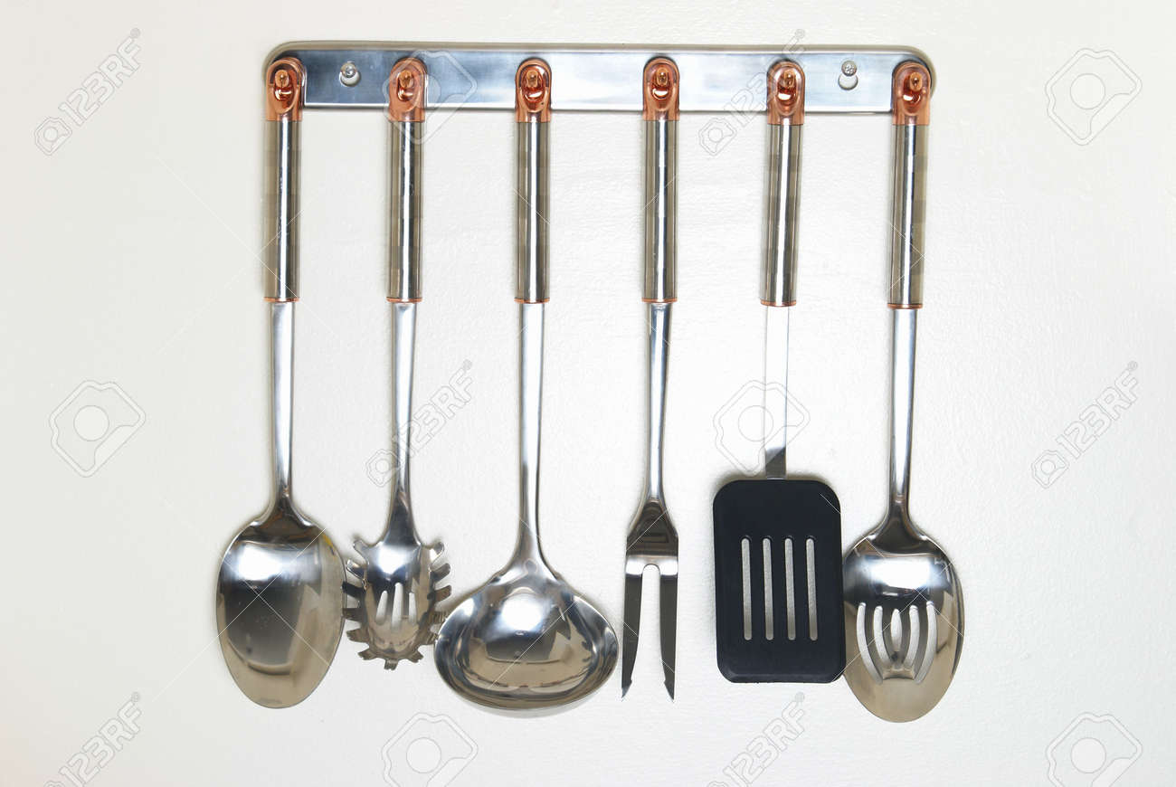 A rack of kitchen utensils hanging on the wall.