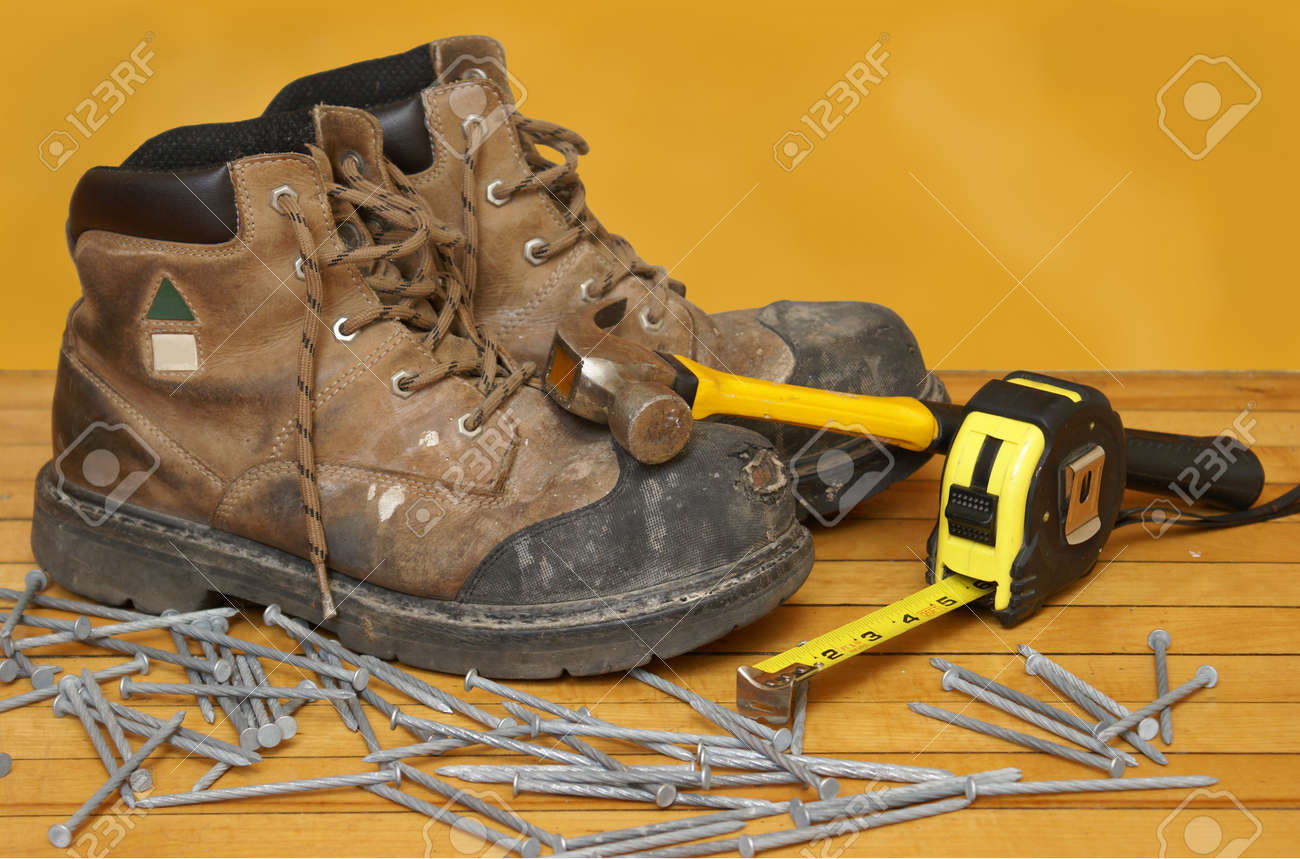 A Pair Of Construction Grade Work Boots With Some Other Tools ...