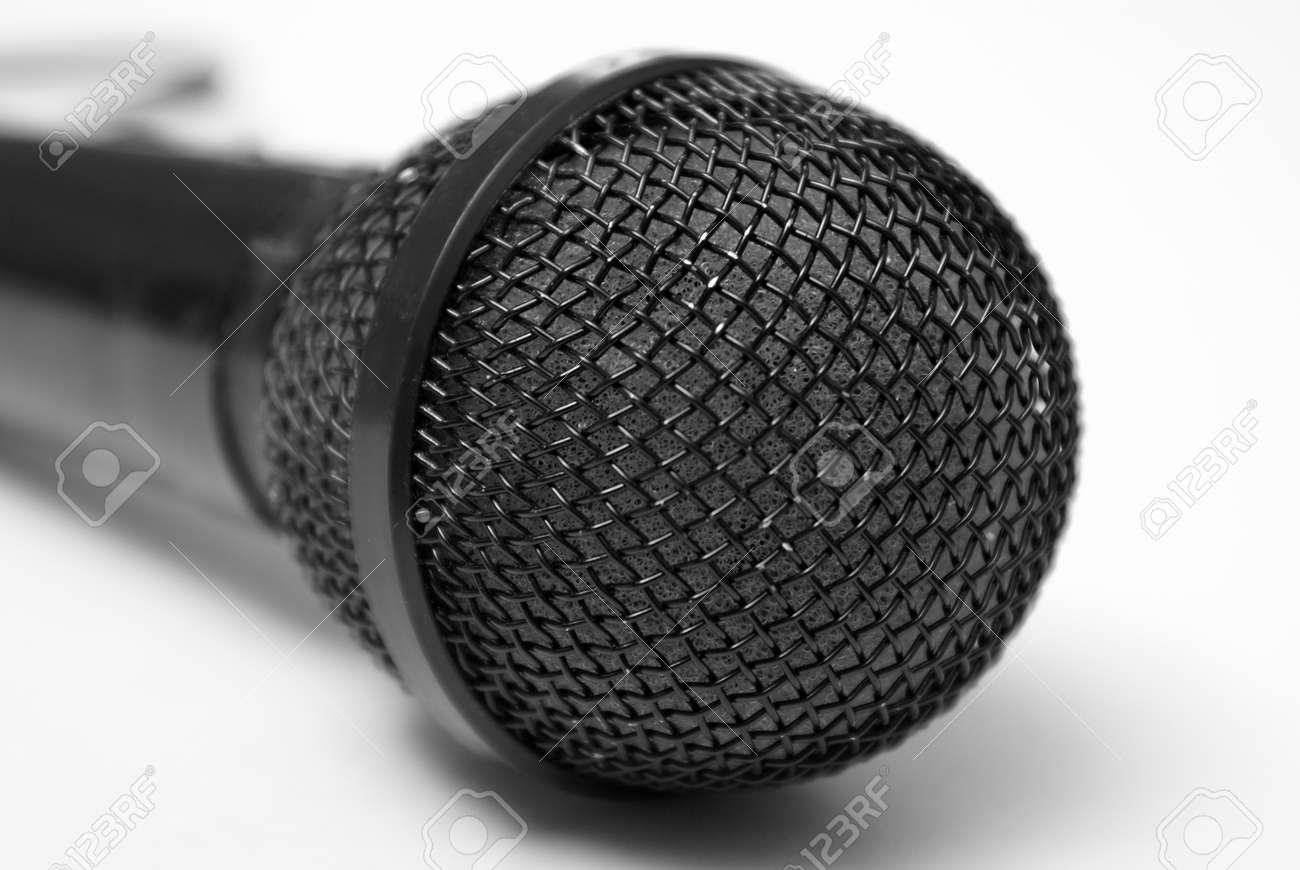 A macro shot of a microphone over a white background. Stock Photo - 7263731