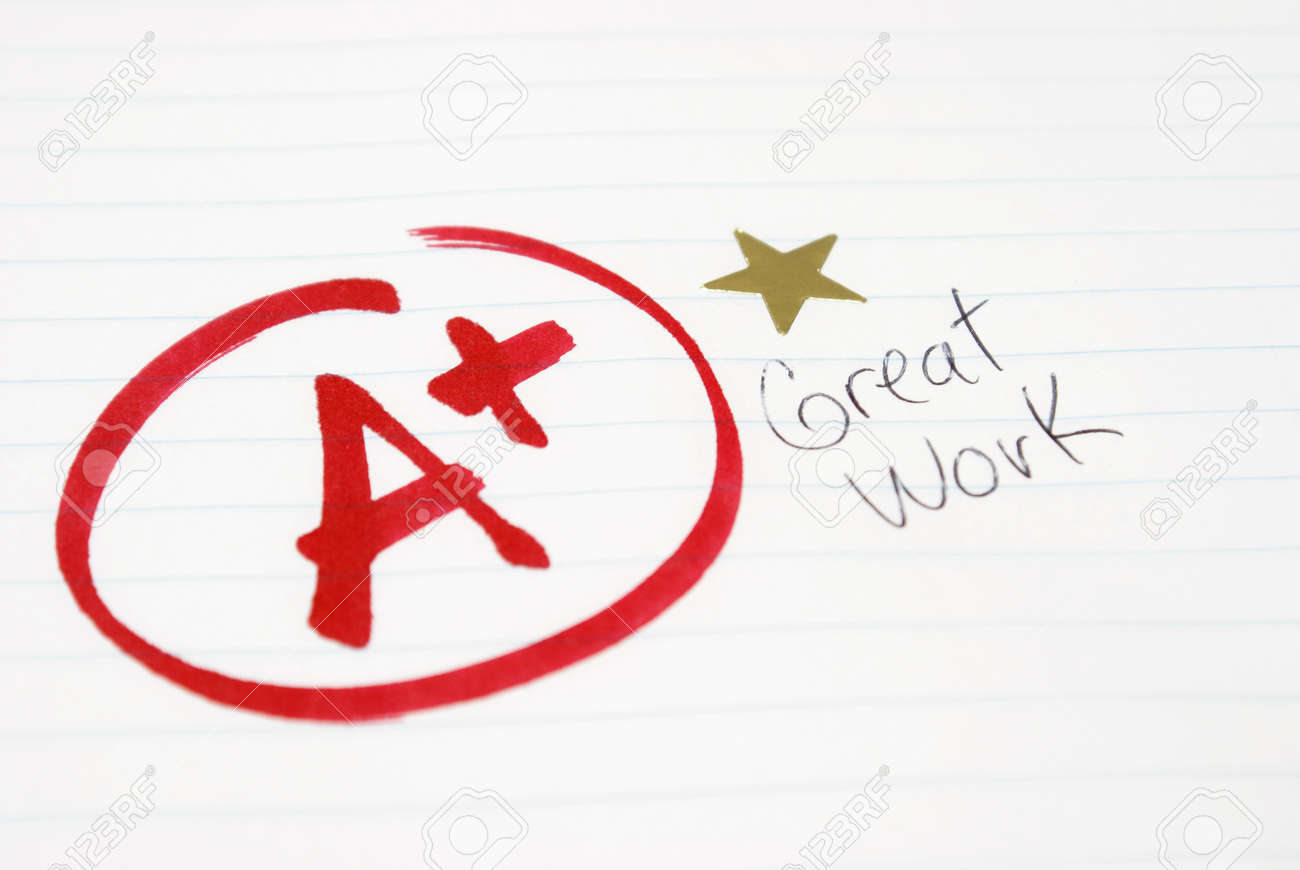 an a plus is given to a student for great work being achieved an a plus is given to a student for great work being achieved stock photo