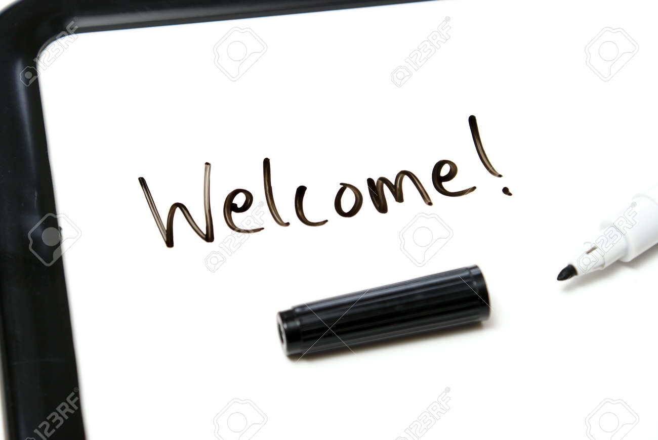 The word welcome is hand written in marker on an office white board. Stock Photo - 7510458