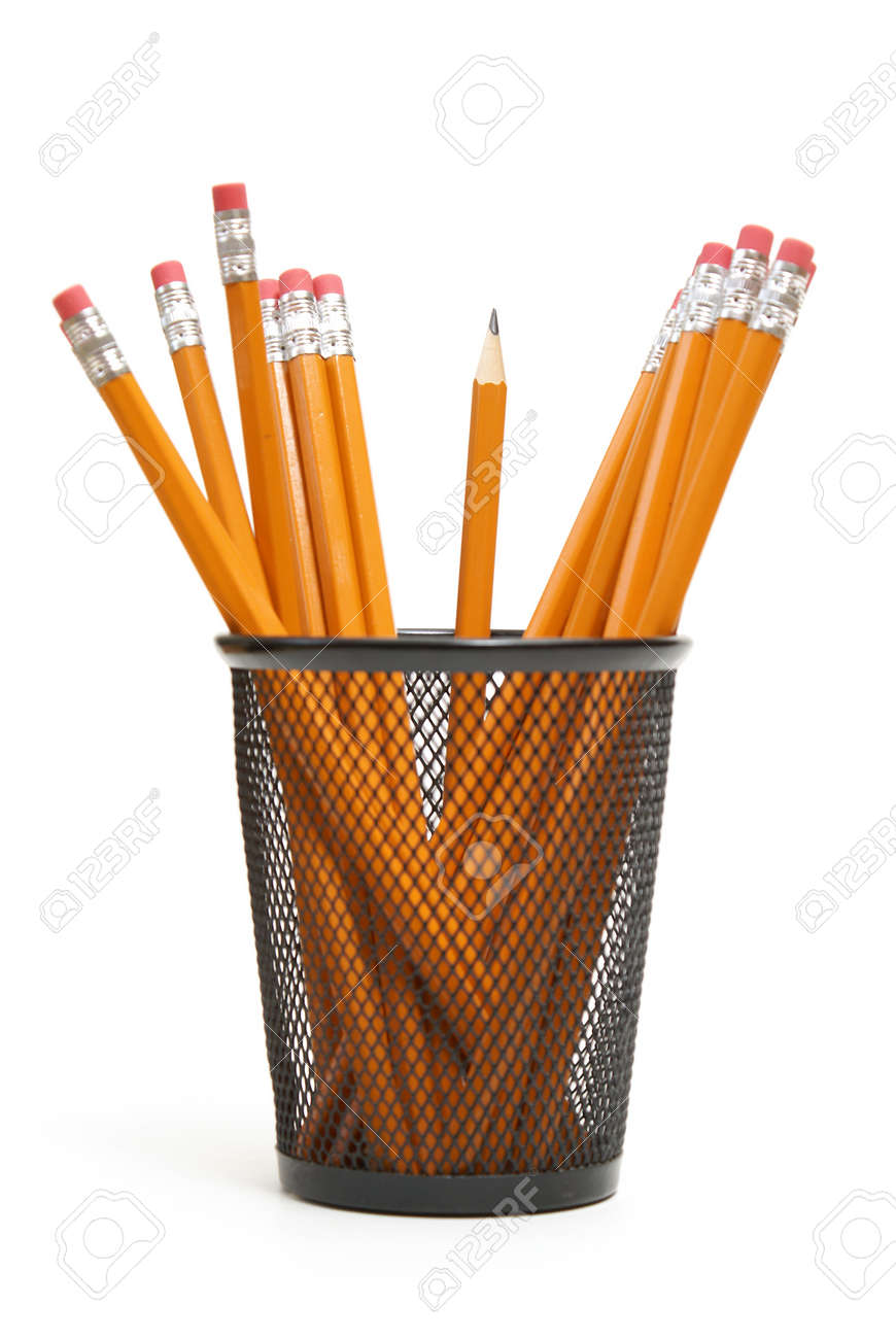 a single sharpened pencil standing upright in amoungst many other
