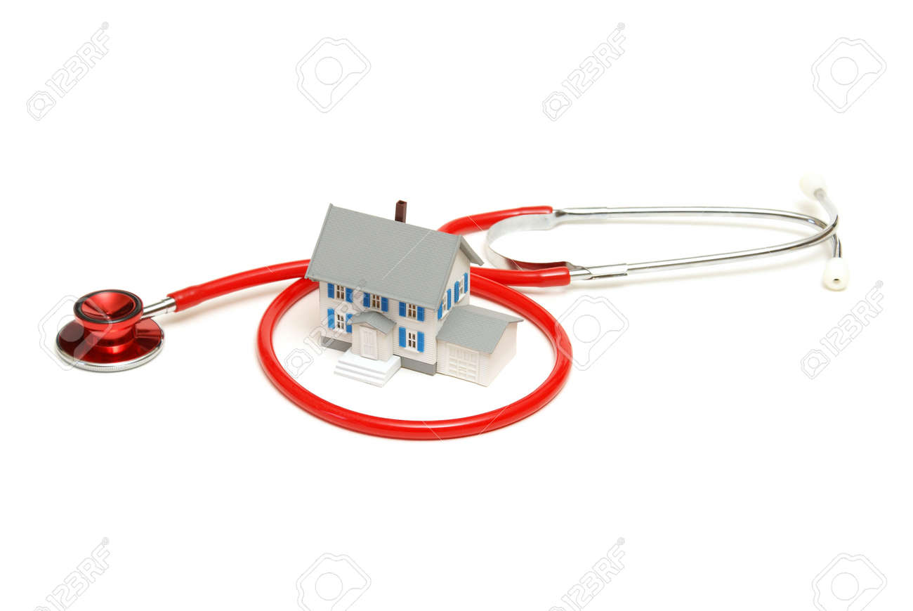 An isolated stethoscope and house represent home nursing or other concepts. Stock Photo - 10019848