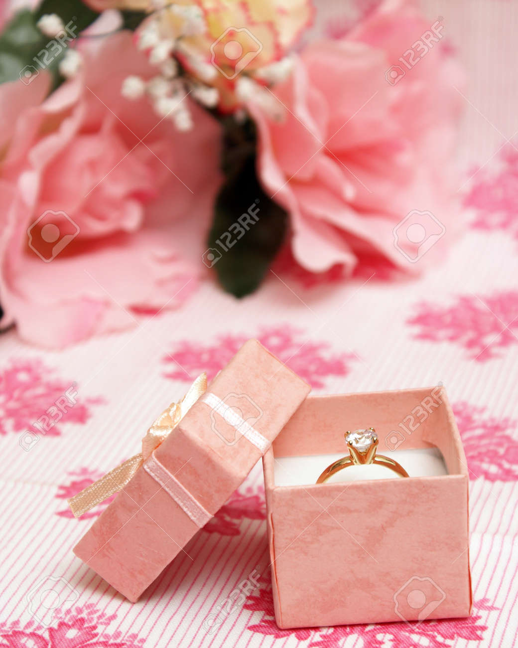 A Beautiful Diamond Ring In A Pink Jewelry Box. Stock Photo, Picture ...