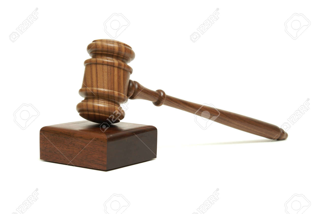An isolated walnut wood gavel with sounding block. Stock Photo - 11281188