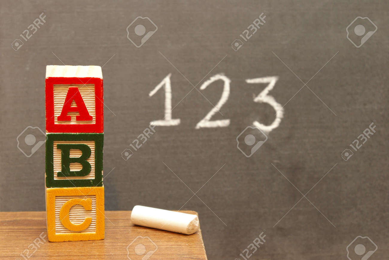 Alphabet blocks and numbers wrote on the chalkboard for learning the basics of the english language. Stock Photo - 12048066