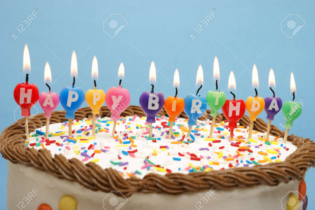A Cake And It S Candles That Read Happy Birthday Stock Photo