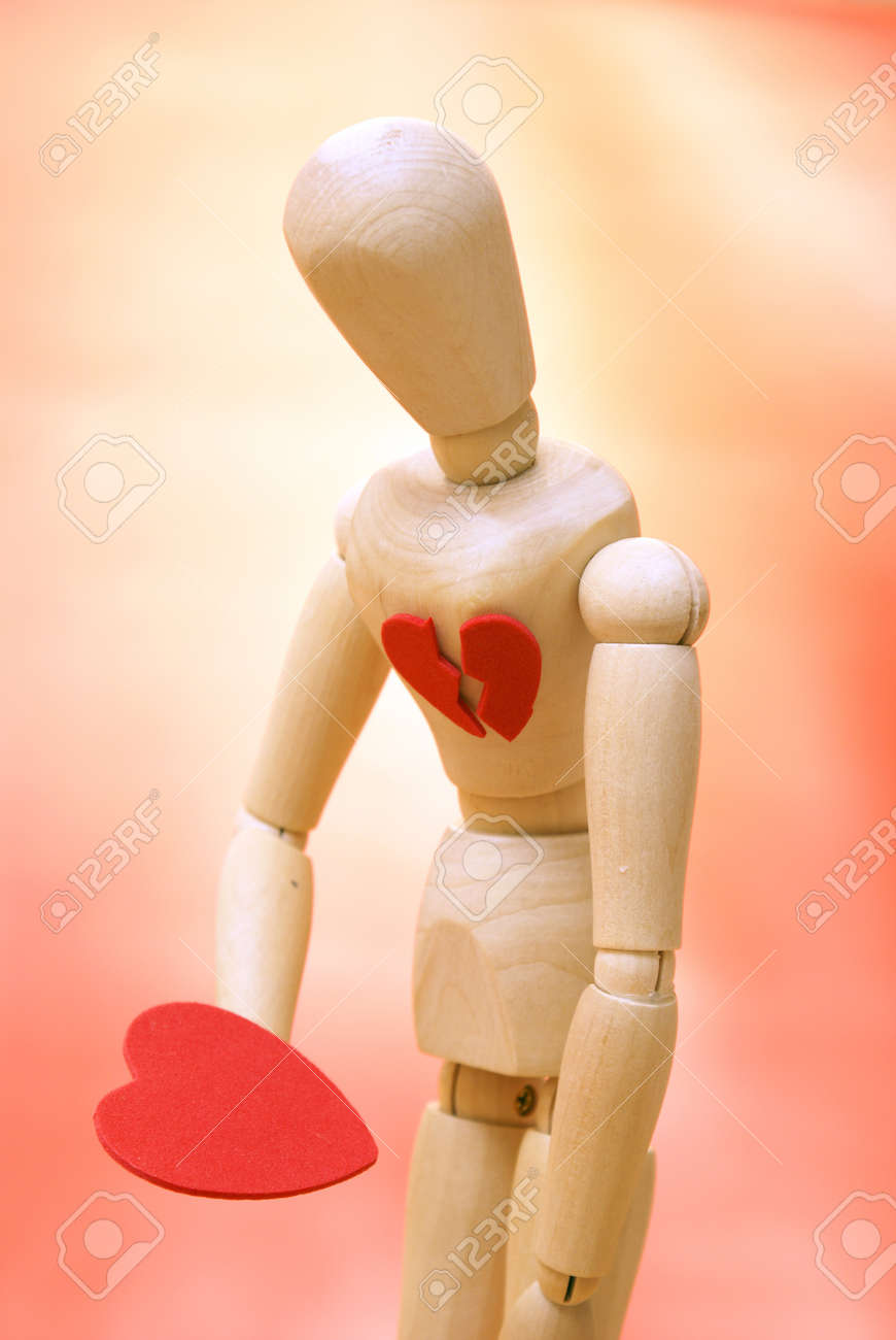 A mannequin looks down to their newly found mended heart. Stock Photo - 15958315