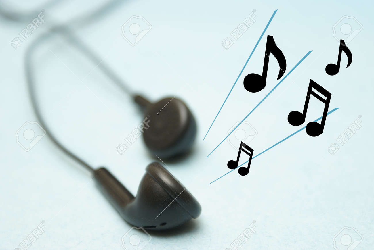 A set of headphones play some musical notes for the listener. Stock Photo - 17212244