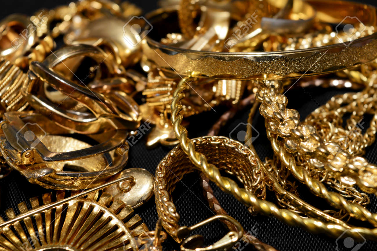 Closeup view of some scrap gold ready for refining. - 100728148