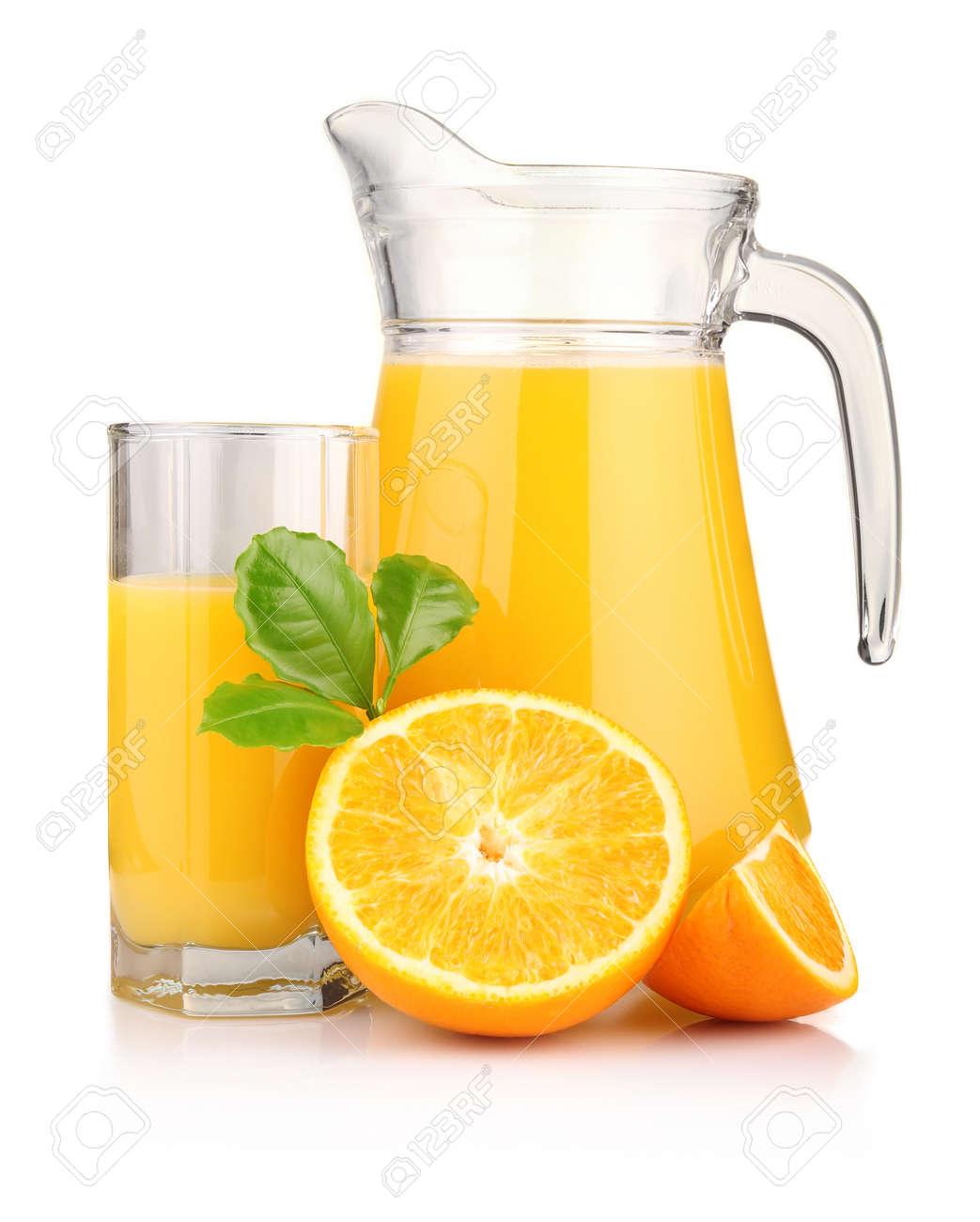 Jug, glass of orange juice and orange fruits with green leaves isolated on white Stock Photo - 9018838