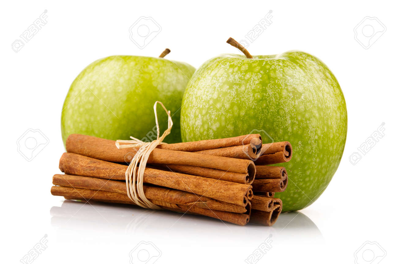 Ripe green apples with cinnamon sticks isolated on white background Stock Photo - 9621776