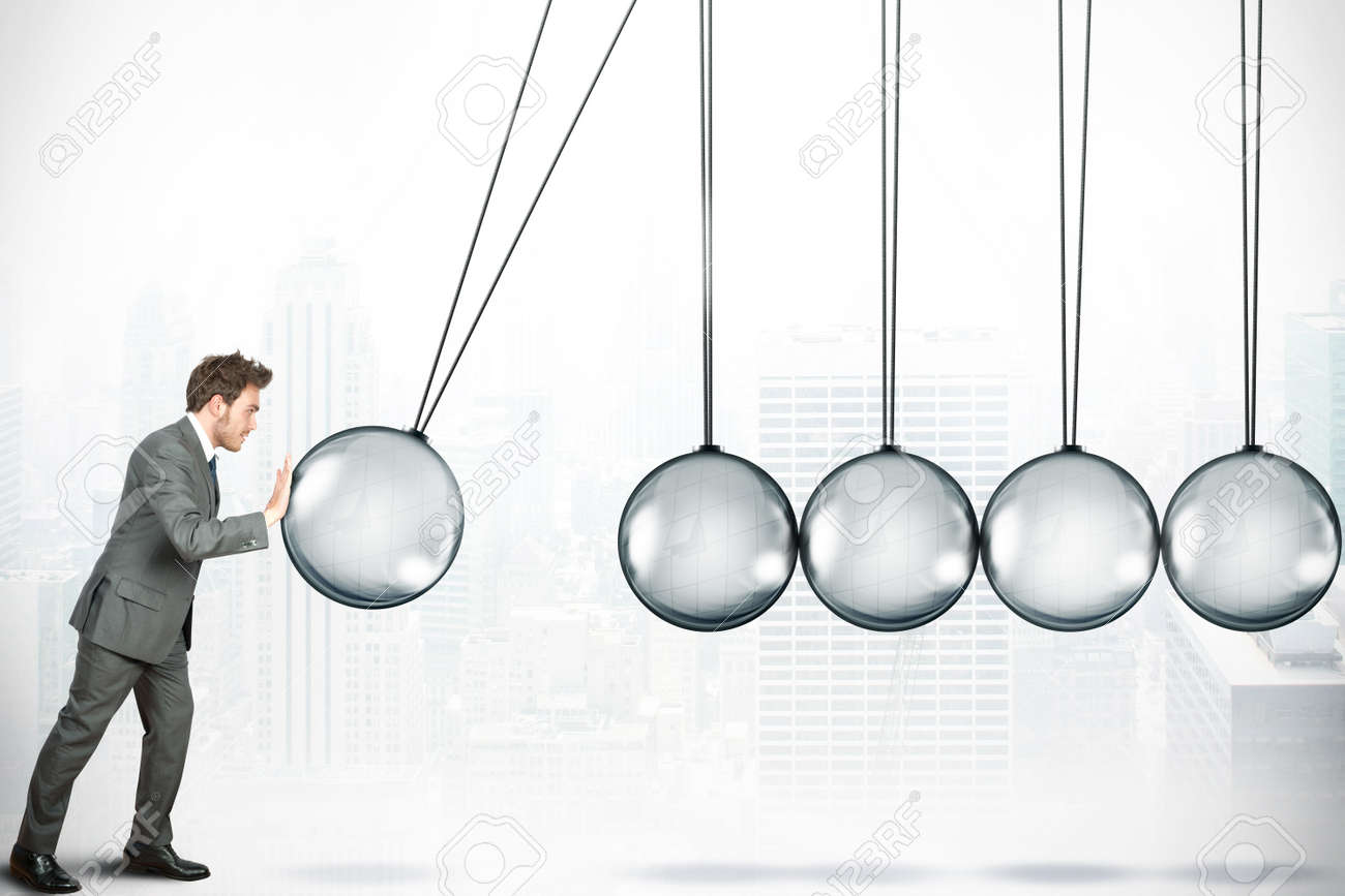 Business challenge concept with Newton cradle Stock Photo - 13823746