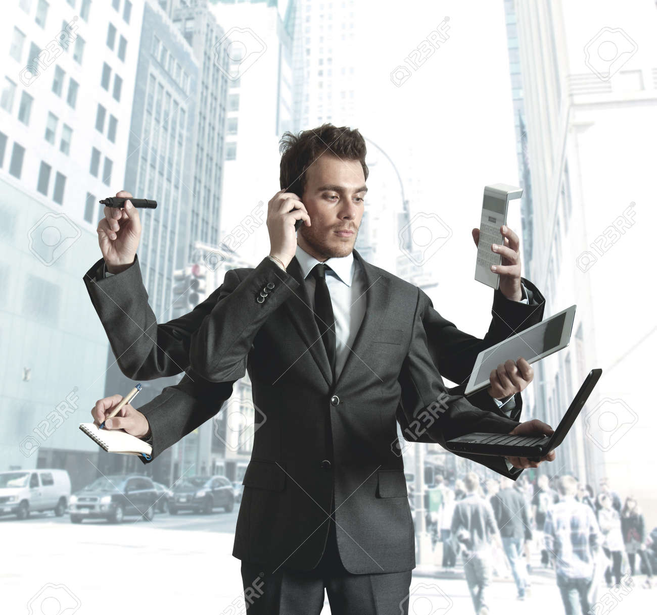 Businessman stressed by too many tasks Stock Photo - 14413184