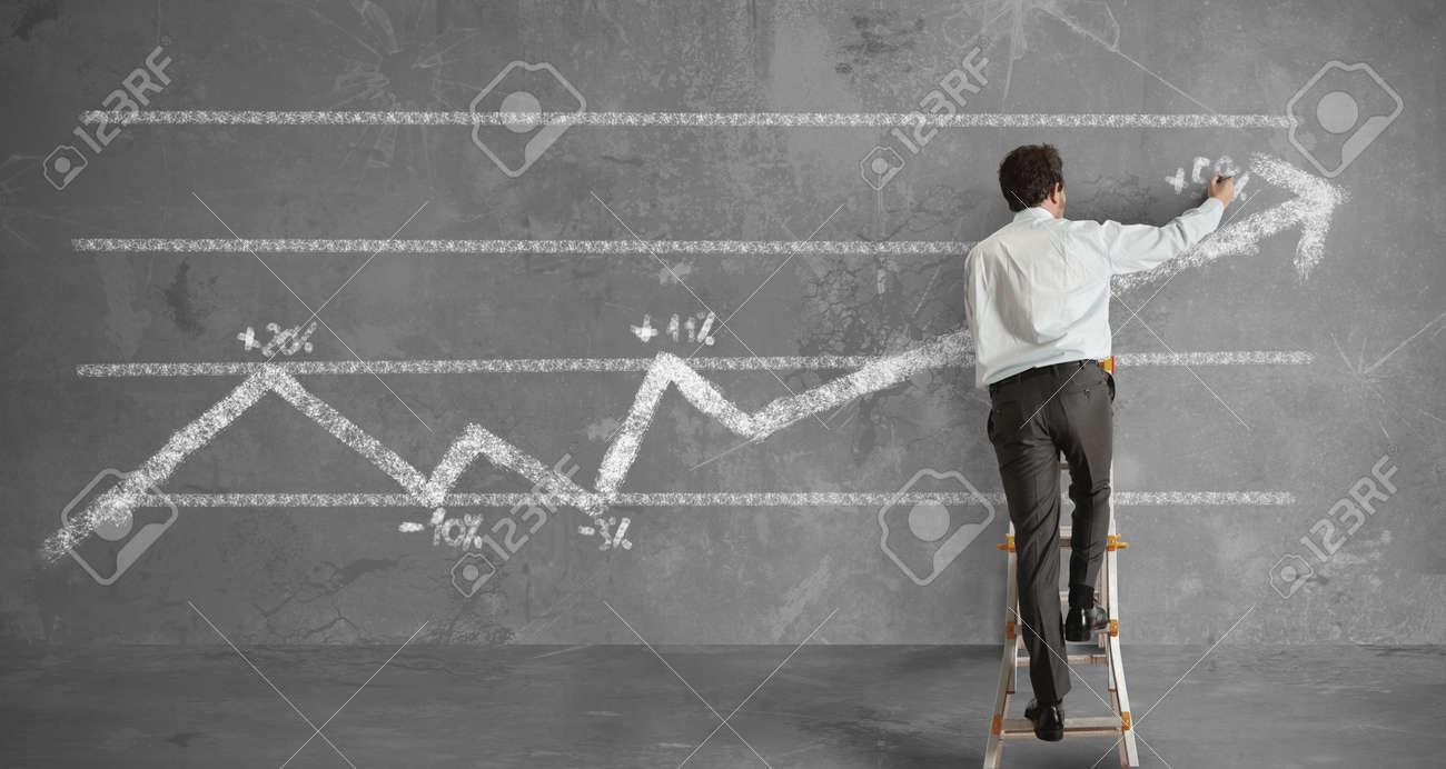 Businessman draws a statistical trend line Stock Photo - 14525524