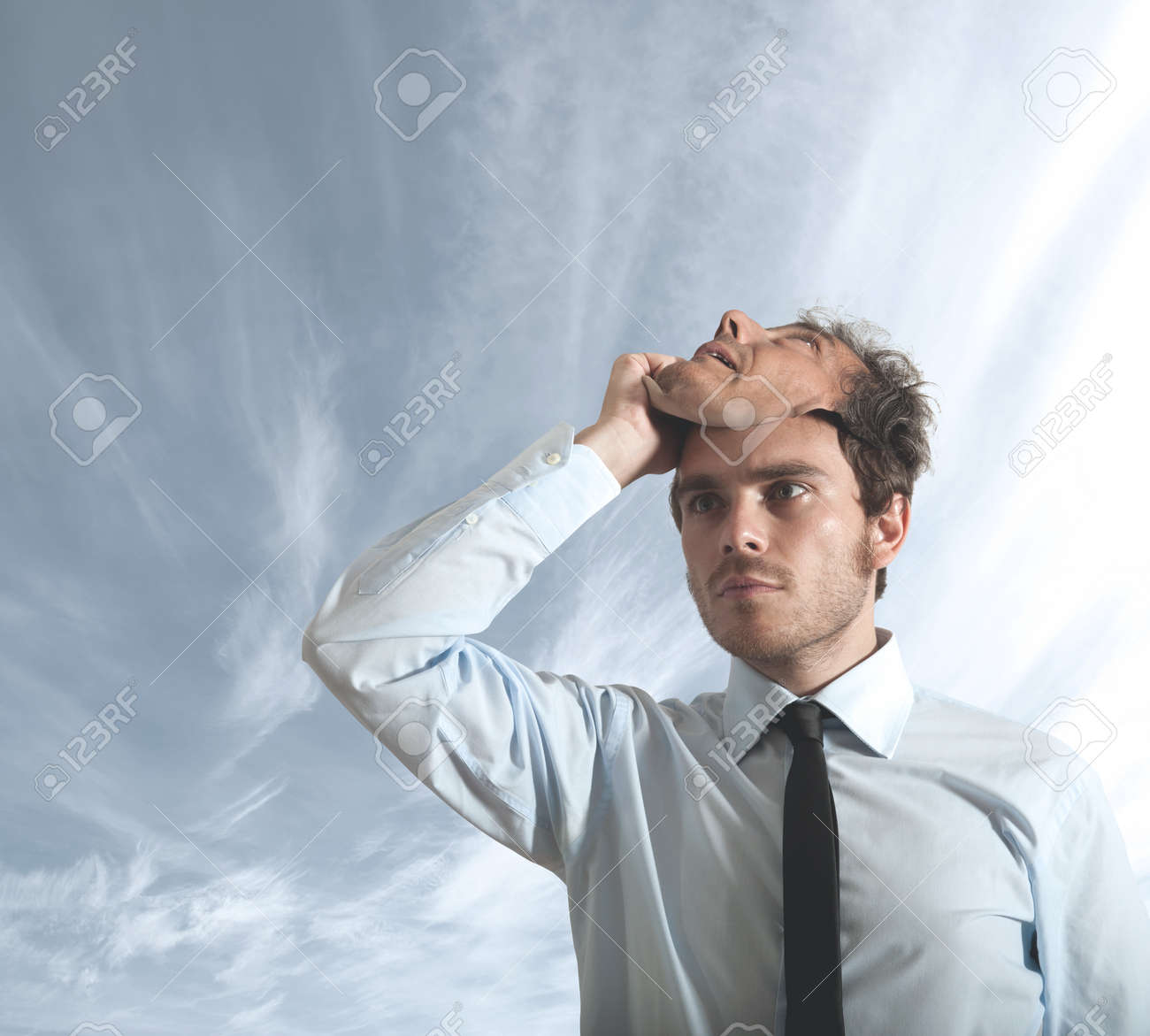 A businessman who hides behind a mask Stock Photo - 14655737