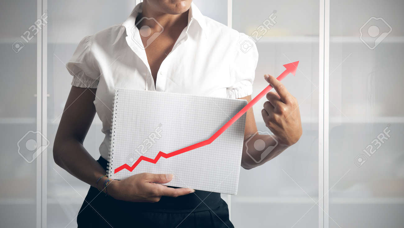 Businesswoman helps statistics trend to growth Stock Photo - 15314495