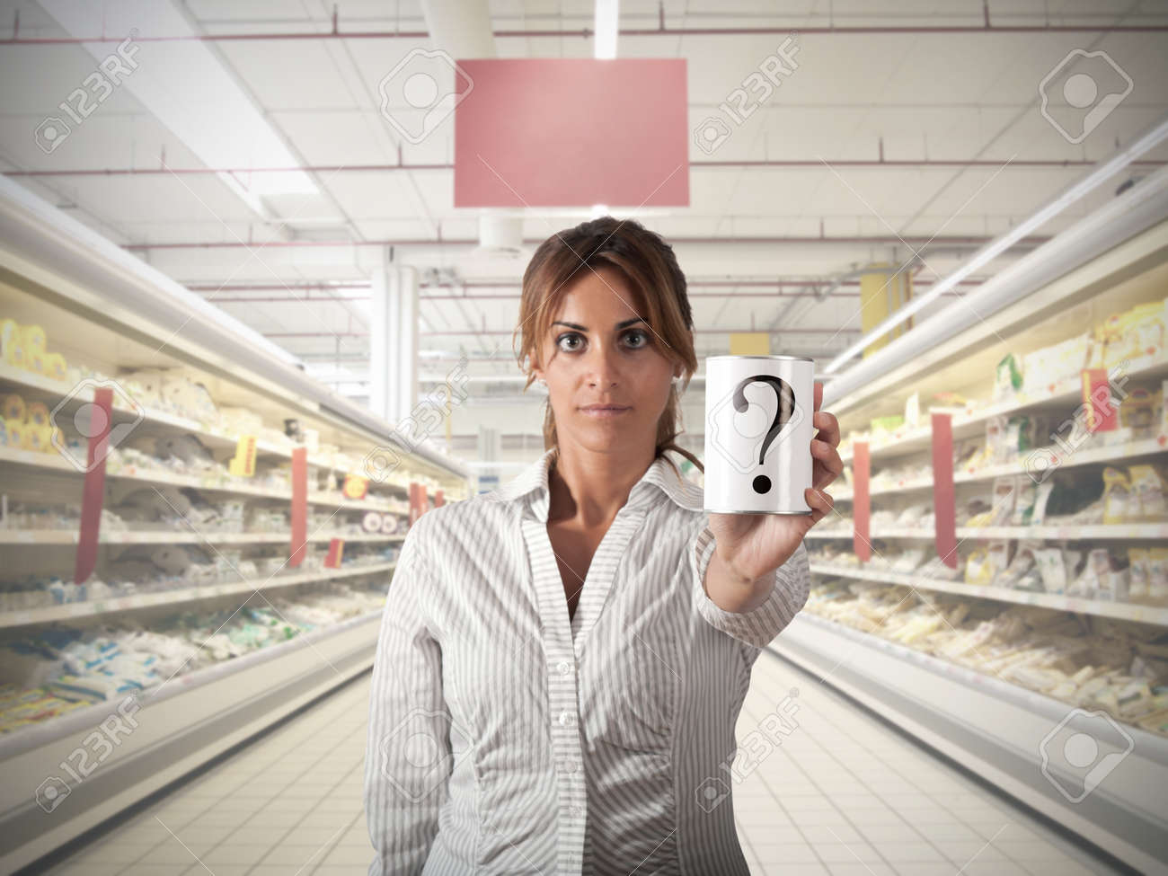 Girl at supermarket that show an unknow product Stock Photo - 16252815