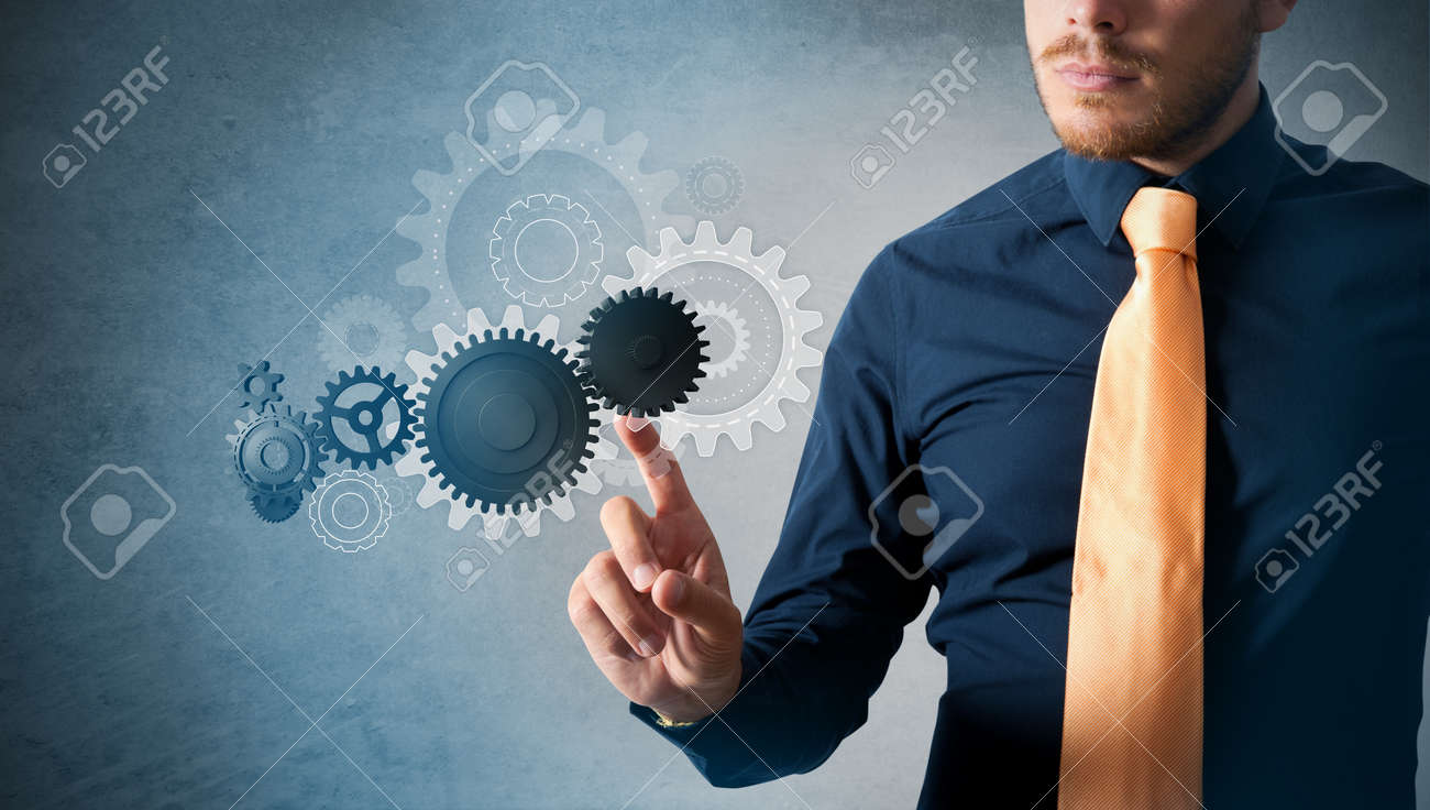 Businessman working on virtual interface with cogwheels Stock Photo - 16828188