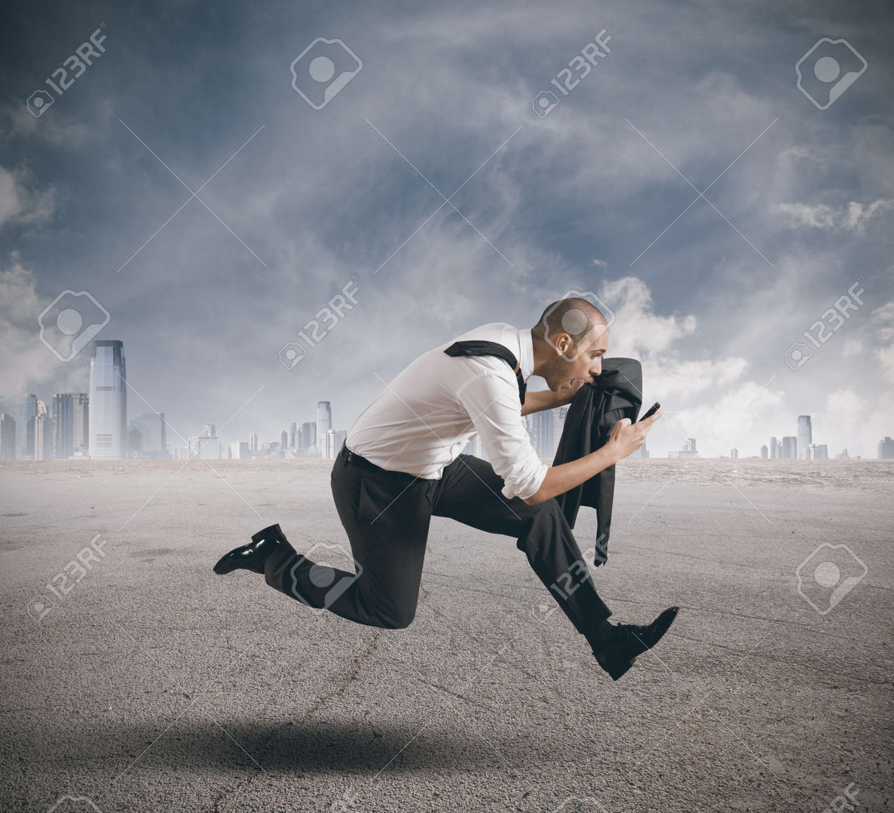 Businessman running with mobile phone in hand Stock Photo - 17244932