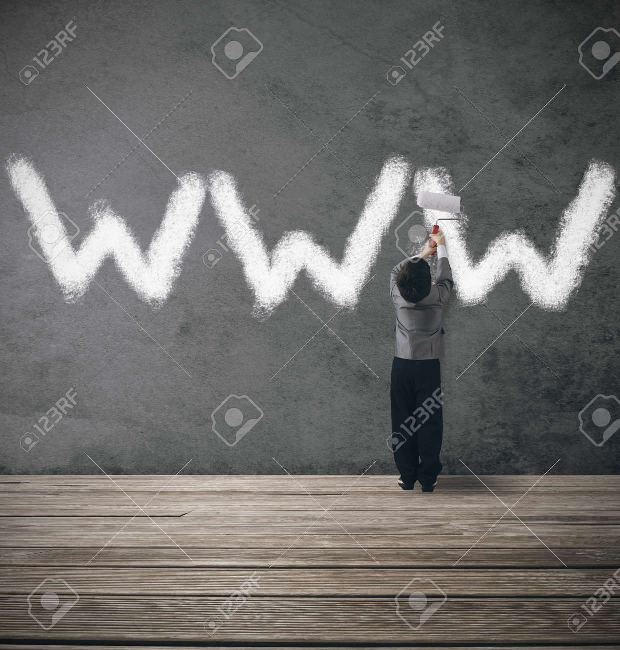Concept of website under contruction with young businessman Stock Photo - 17388090