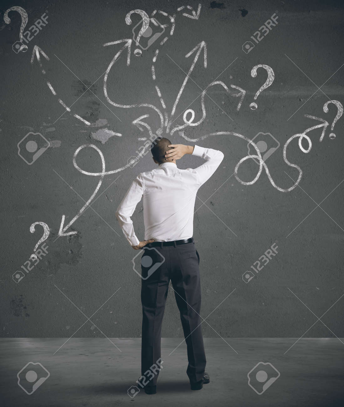 Businessman looking at arrows pointed in different directions Stock Photo - 17624886