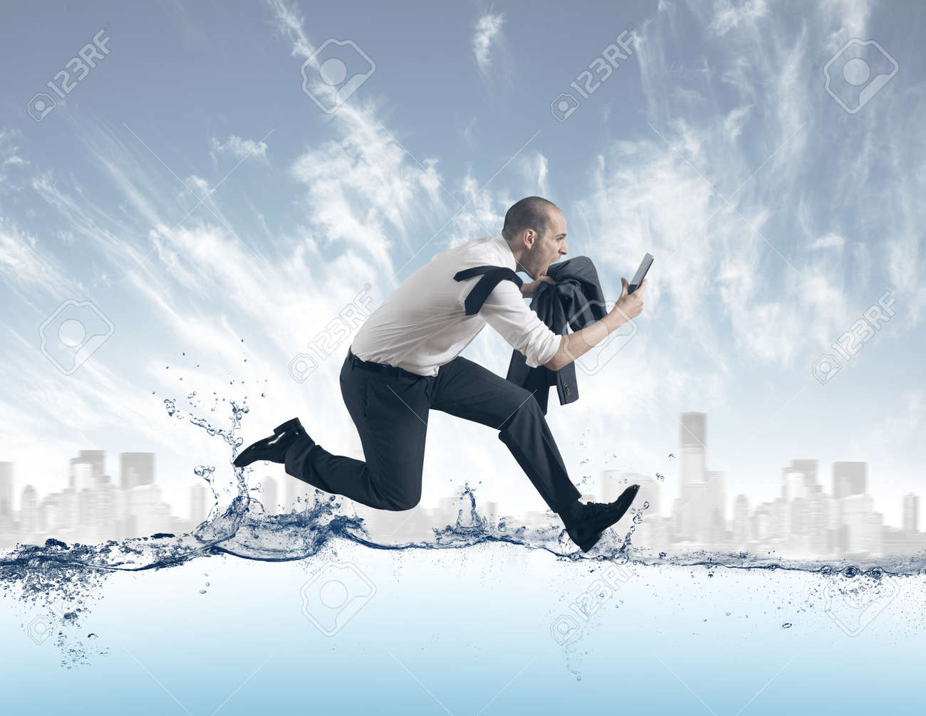 Concept of of stress with businessman running on the water Stock Photo - 17850084