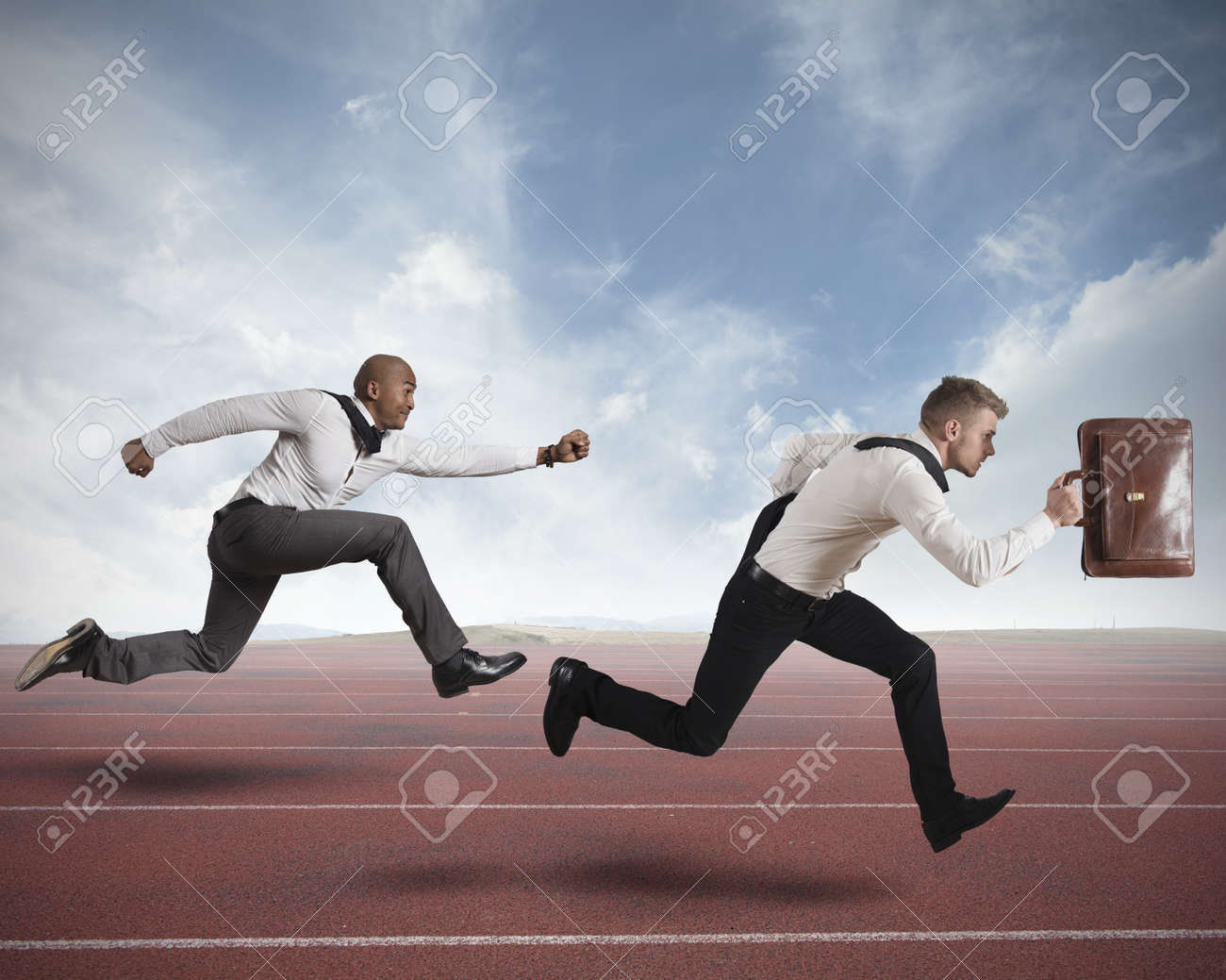 Conceot of competition with two running businessman in a track - 18184243