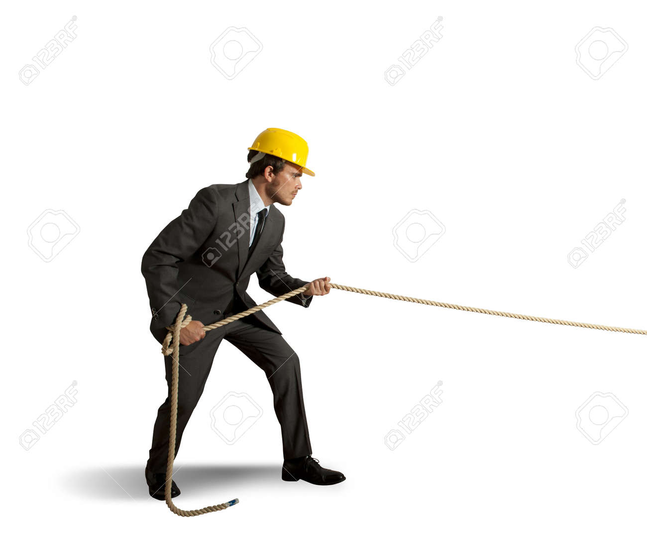 Businessman pulls the rope on white background Stock Photo - 18199546