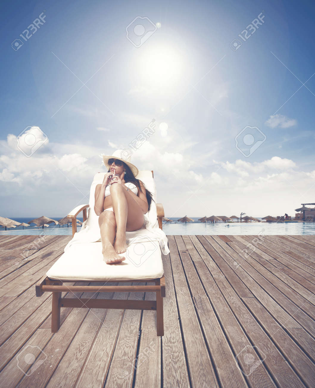 Girl relaxing on a tropical beach resort Stock Photo - 19609309