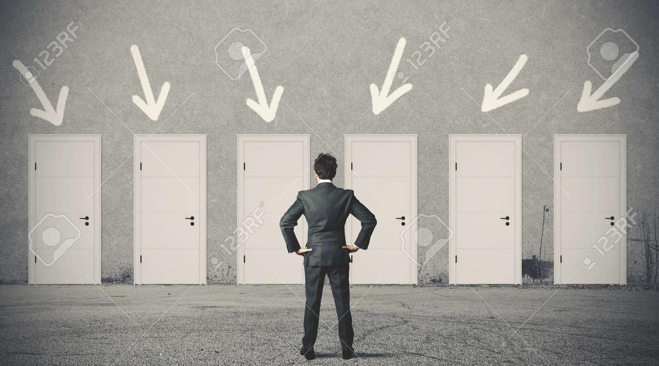 Concept of businessman choosing the right door - 20411748
