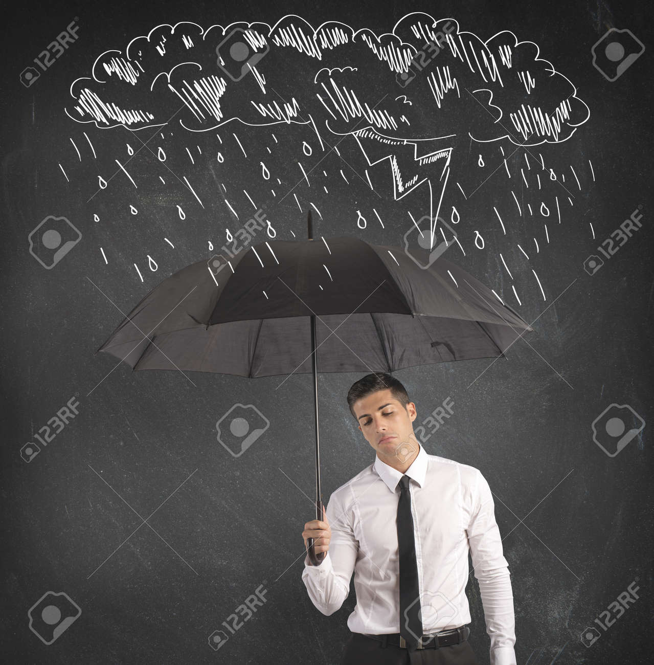 Concept of difficulty in business with umbrella Stock Photo - 20706240