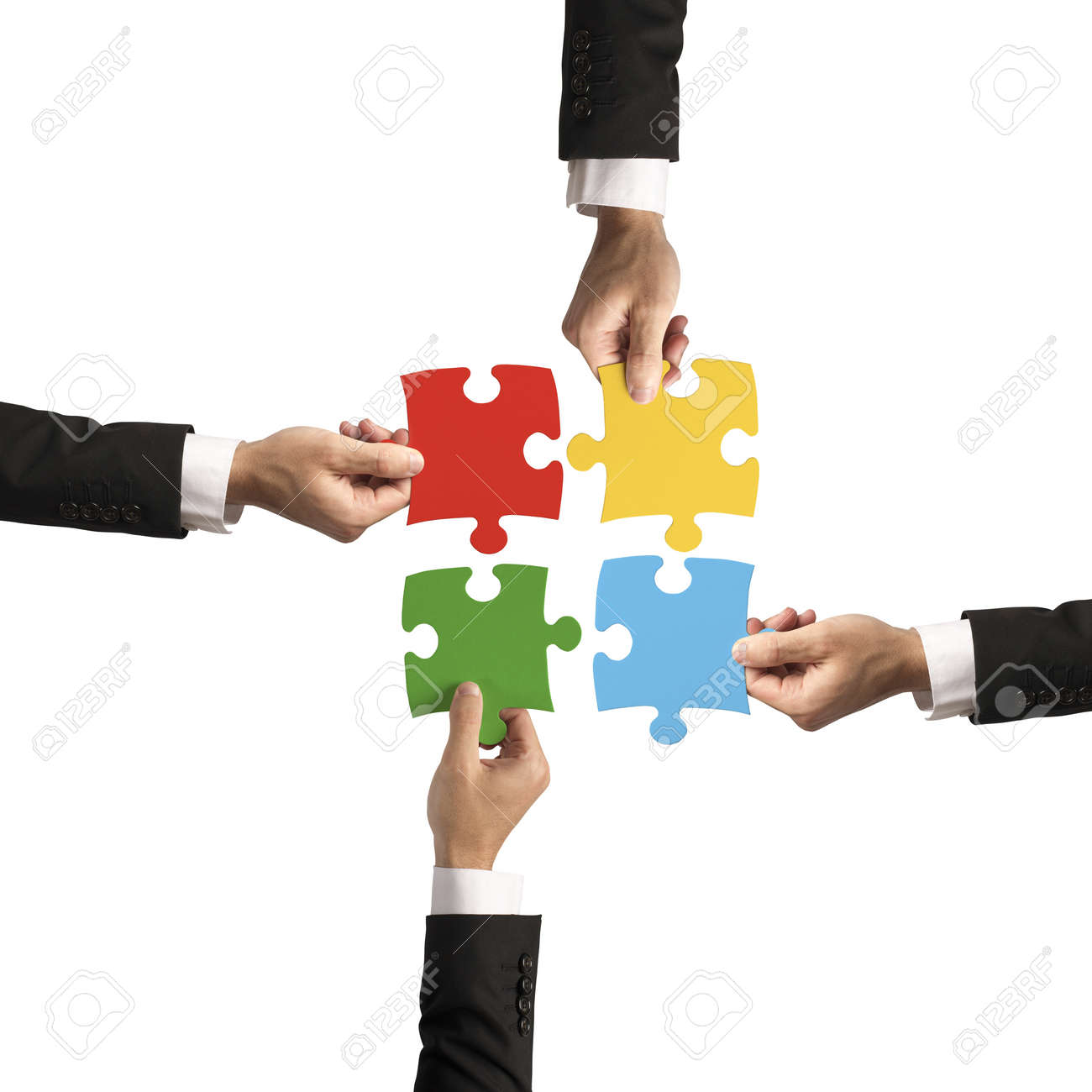 Teamwork and partnership concept with puzzle Stock Photo - 21306345