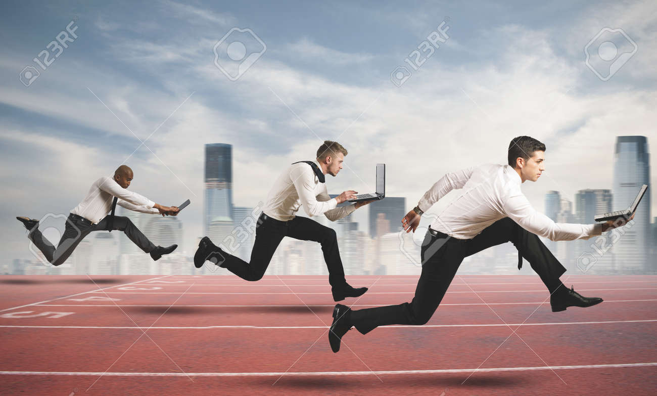 Competition in business concept with running businesspeople - 21139692