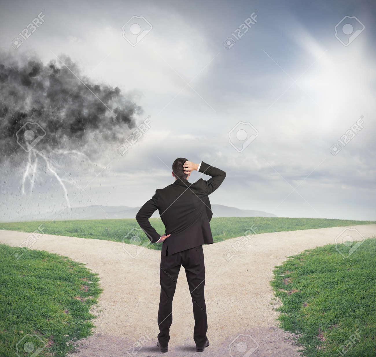 Businessman at a crossroads with storm and sunshine - 21393275