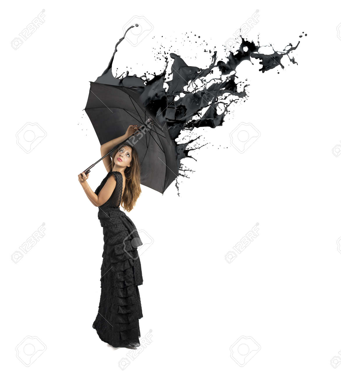 Concept of black color splash with girl holding umbrella Stock Photo - 22070345