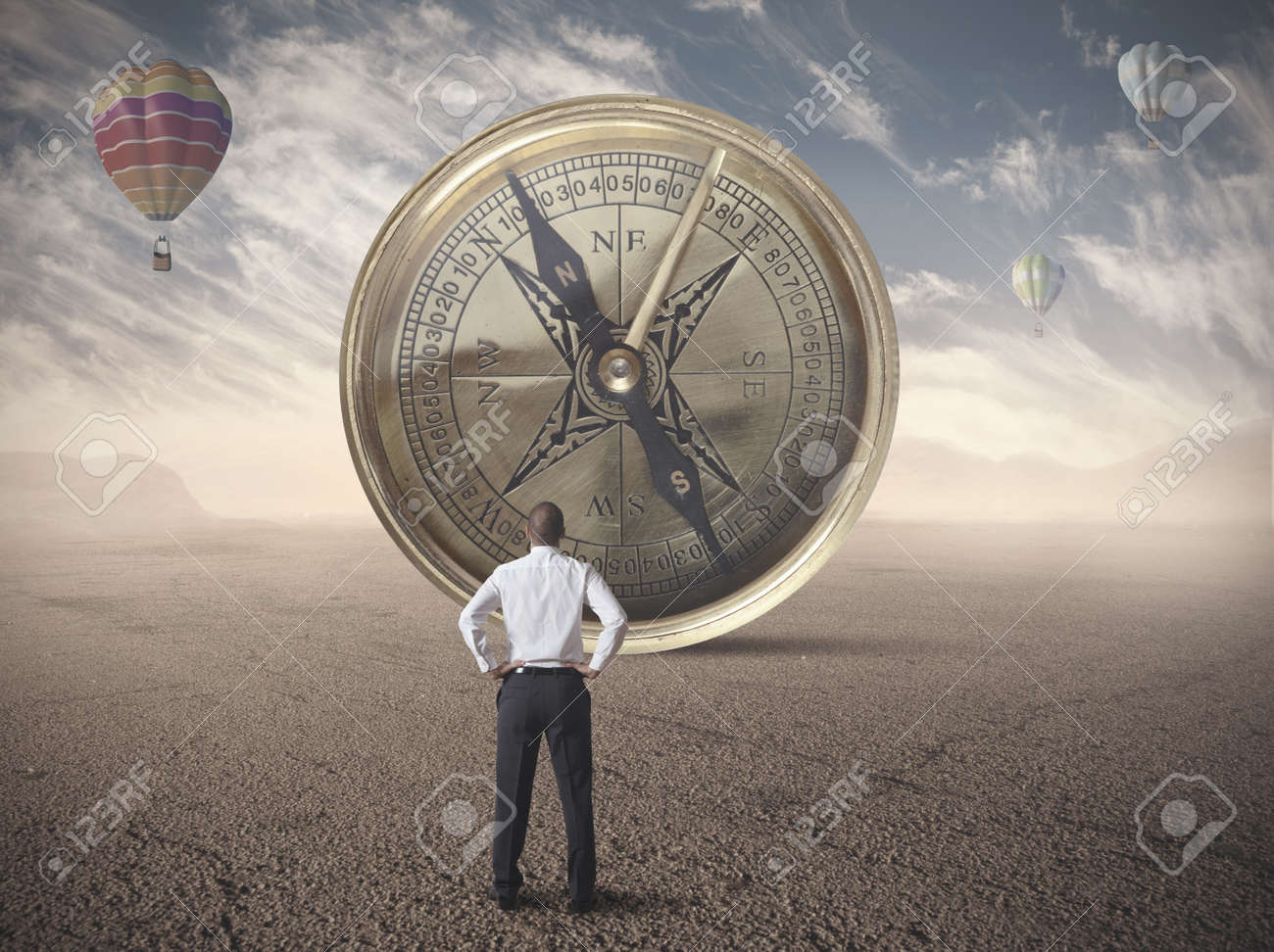 Businessman looking for the destination of business compass Stock Photo - 22244312