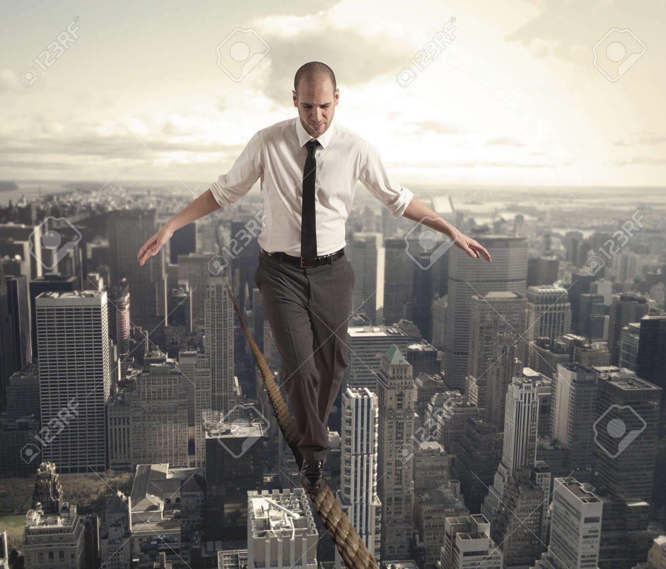 Concept of difficulty in business with equilibrist businessman Stock Photo - 22244313