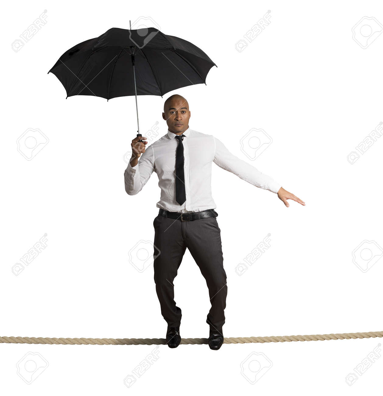 Concept of risk in business with businessman on the rope Stock Photo - 22384732