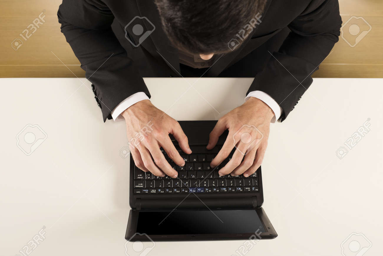 Businessman working on notebook in a desk Stock Photo - 22397436