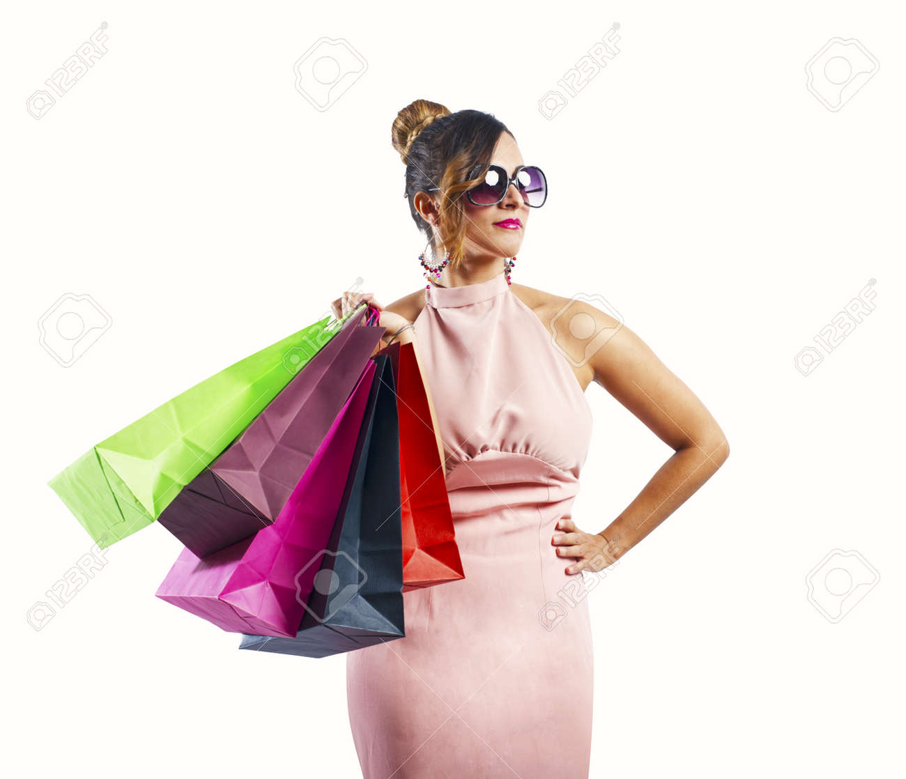 Beautiful young woman holding several shopping bags Stock Photo - 22720049